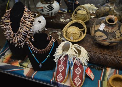 Native American Items pottery, moccosins, necklaces, and Tohono O'odham Indian baskets which are handmade using Native Plants such as Yucca, Beargrass,and Devils Claw. These Native American weavers rely on the natural colors of the desert plants